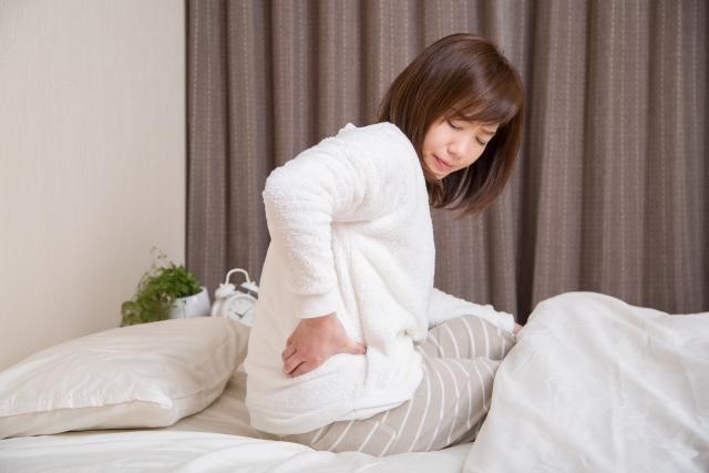 骨盤の歪みからくる体調不良に悩む女性